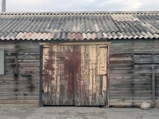 Gate in a wooden hangar