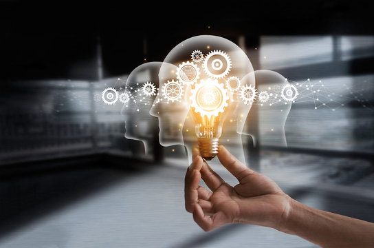 Hand holding light bulb and cog inside. Idea and imagination. Creative and inspiration. Innovation gears icon with network connection on human heads. Innovative technology in science concept