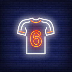 Football kit with player number on brick background. Neon style