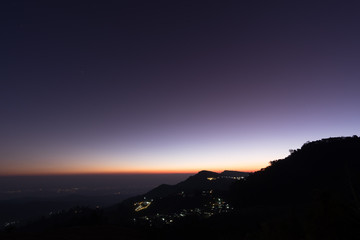 Silhouette image of Sunrise on the mountain.