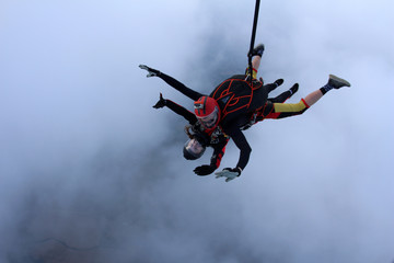 Tandem skydiving. Face to face jump.
