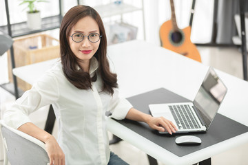 Asian woman using laptop at home,