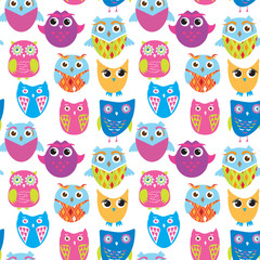 Seamless vector pattern with cartoon doodle owls.