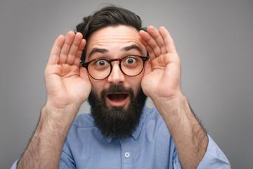 Expressive man revealing eyes in surprise