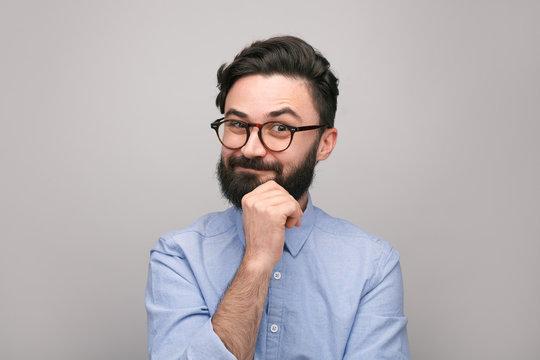 Playful bearded guy in eyeglasses