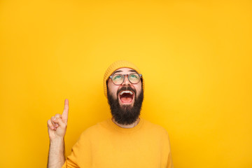 Excited guy in yellow pointing up