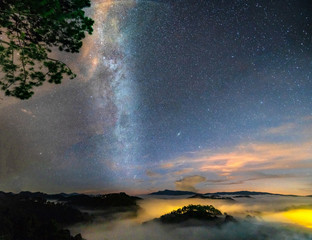 Foto op Plexiglas Oranje Night landscape with the Milky Way in the sky at the rural highlands