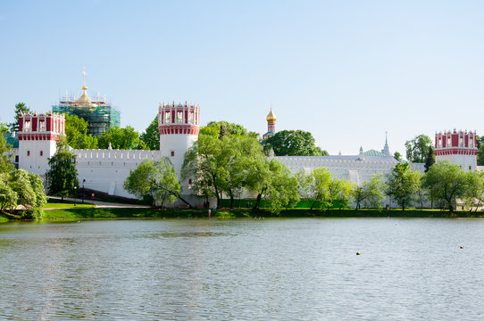 Novodevichy Convent, also Bogoroditse-Smolensky Monastery seen from the pond in Moscow , Russia.