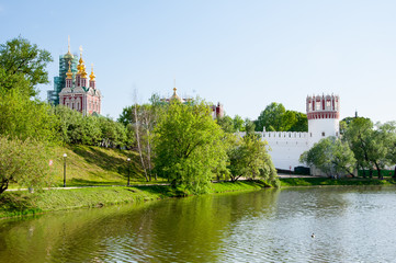 Novodevichy Convent, also Bogoroditse-Smolensky Monastery located in the southwestern part of Moscow on bank of the Moscow River as seen from the local pond in Moscow , Russia.