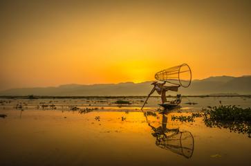 Fisherman during sunrise in Lake Inle