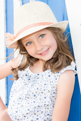 Beautiful Little Girl with straw hat Posing for Camera