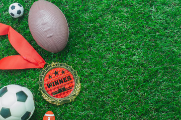 Table top view aerial image soccer or football tournament season background.Flat lay ball with accessories decorations items on the artificial green grass wallpaper.free space for creative design text