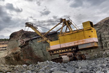 excavator works with granite or ore at opencast mining