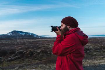 Man taking photos of Iceland landscape