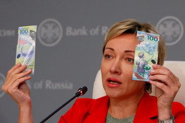 Russian central bank deputy chairwoman Skorobogatova holds the newly designed 100-rouble banknotes dedicated to the 2018 FIFA World Cup, during a news conference in Moscow