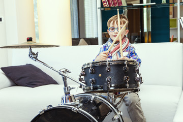 prodigy child plays the drums at home