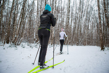 Picture of sports two woman skiing in winter forest