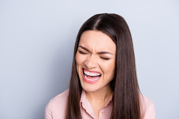Portrait of psycho, nervous, crying, uncontrollable woman with violent irritated reaction, shouting with close eyes, grimace, tired from routine isolated on grey background