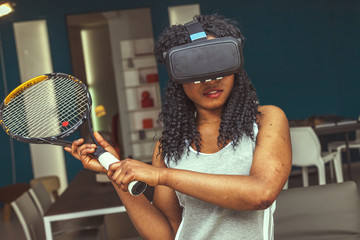 young beautiful woman plays tennis at home