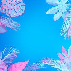 Wall Mural - Tropical and palm leaves in vibrant bold gradient holographic neon  colors. Concept art. Minimal surrealism summer background.