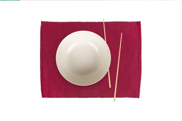 Empty White Plate with Chopsticks on Mat