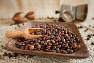 coffee roasted beans  next to an Italian moka