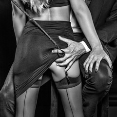Man with whip grab sub woman lovers ass black and white