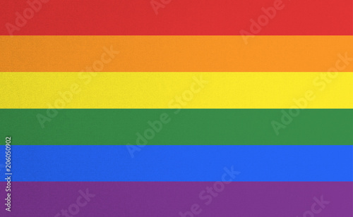 Rainbow flag pattern on fabric texture for LGBT pride for transgender day of remembrance and transgender awareness week concept