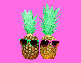 Fashion two pineapple with sunglasses on pink background, colorful ananas photo