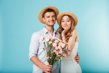 Happy caucasian people man and woman holding flowers.