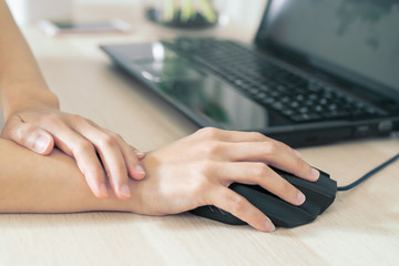 woman wrist arm pain long use mouse working. office syndrome healthcare and medicine concept