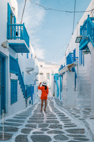 Young Woman On Vacation At The Greek Island Mykonos Or Mikonos