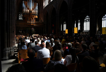 People attend the Manchester Arena National Service of Commemoration at Manchester Cathedral in central Manchester