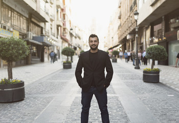 Cool man posing in the street looking at camera