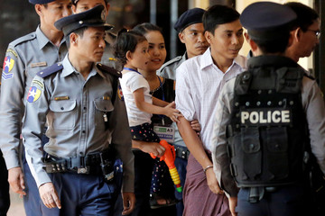 Moe Thin Wai Zin, daughter of detained Reuters journalist Kyaw Soe Oo reacts as he arrives for a court hearing in Yangon