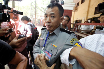Prosecution witness police captain Moe Yan Naing walks outside the court room during a hearing of detained Reuters journalists Wa Lone and Kyaw Soe Oo in Yangon