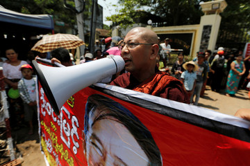 Buddhist activist monk Parmaukkha shouts as newly released prisoners, part of over 8,000 inmates granted amnesty by Myanmar's President Win Myint to mark Myanmar's new year, walk out from Insein prison in Yangon