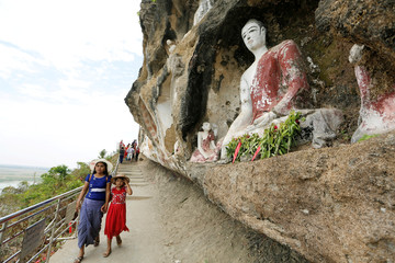 Local people visit Akauk Taung Buddha cliff carvings pagodas next to the UNESCO world heritage site of Pyu Ancient Cities outside Pyay