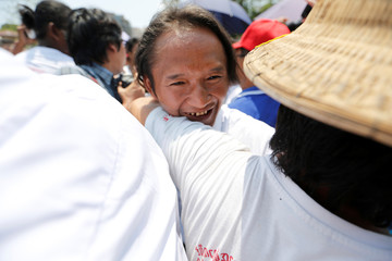 A newly released prisoner, part of over 8,000 inmates granted amnesty by Myanmar's President Win Myint to mark Myanmar's new year, hugs his family outside Insein prison in Yangon