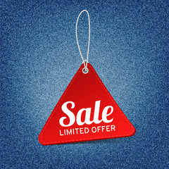 Vector red sale tag on denim background. Vector label for design banners and flyers.