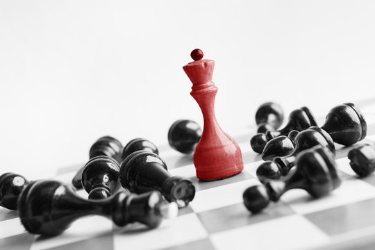 White chess queen beats blacks on chessboard