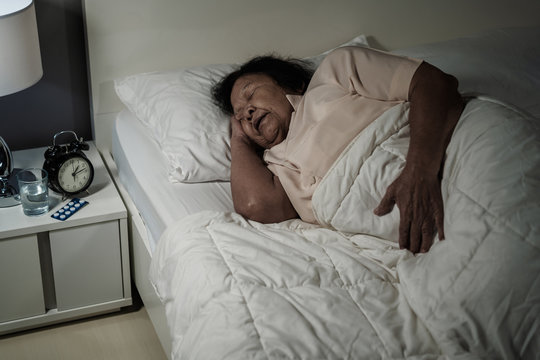 senior woman sleeping in a bed