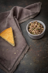 A Slice of Homemade Buttermilk Cornbread with a Bowl of Field Peas and Snaps Beans on a Dark Background