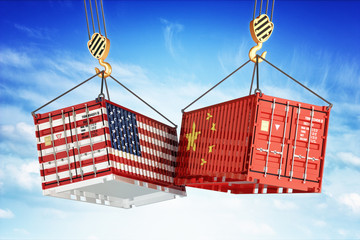 Economic trade war between USA and China, freight transportation concept, cargo containers with USA and China flags hoisted by crane hooks on blue cloudy sky background