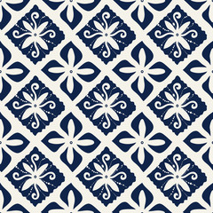 Seamless indigo dye woodblock printed damask pattern. Traditional oriental ornament of Indonesia, with flowers and double diamonds, navy blue on ecru background. Textile design.