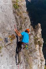 Climber scramble to the top on mountain