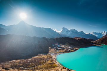 The spectacular sunset in the Himalays. Stunning panoramic view the mighty mountains and Gokyo Lake. Everest Base Camp trek in the Sagarmatha National Park in the north-eastern Nepal.