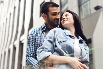 Couple in love near glass barrage.