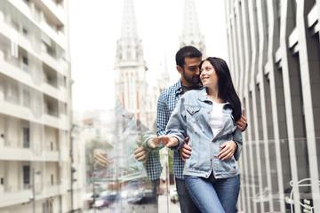 Couple in love on summer terrace of restaurant.