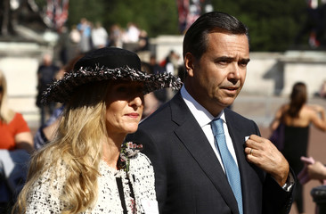 Antonio Horta Osorio, CEO of Lloyds Banking Group, and his wife Ana arrive at a garden party at Buckingham Palace, London